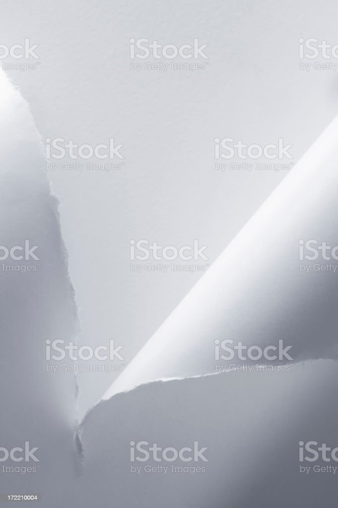 Piece of paper being torn in half royalty-free stock photo