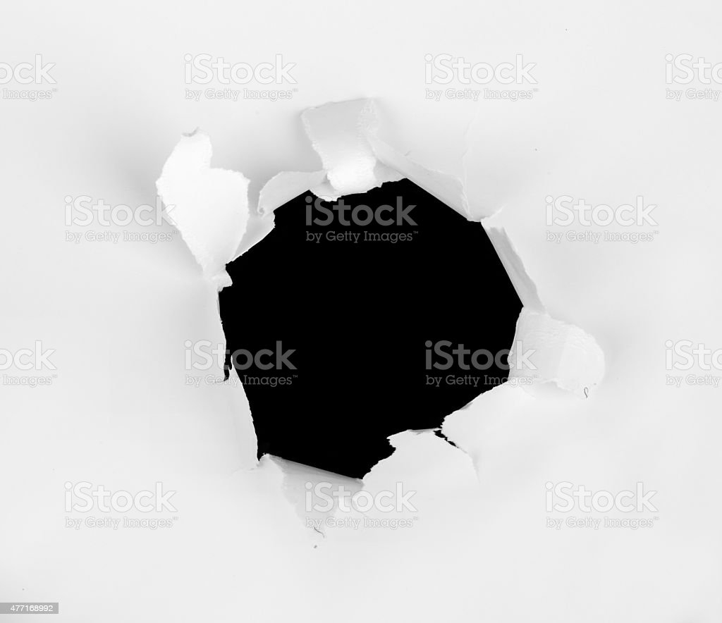 Piece of paper with hole in center stock photo