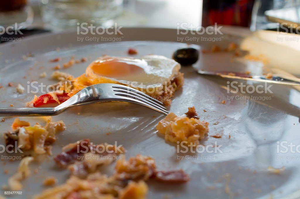 Piece of pizza remains on plate stock photo