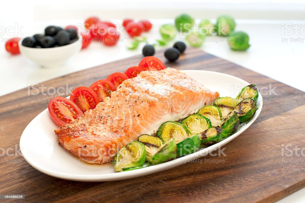 Piece of roasted salmon fillet with grilled vegetables stock photo