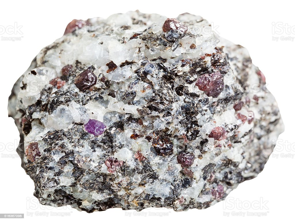 piece of rock with Corundum crystals isolated stock photo