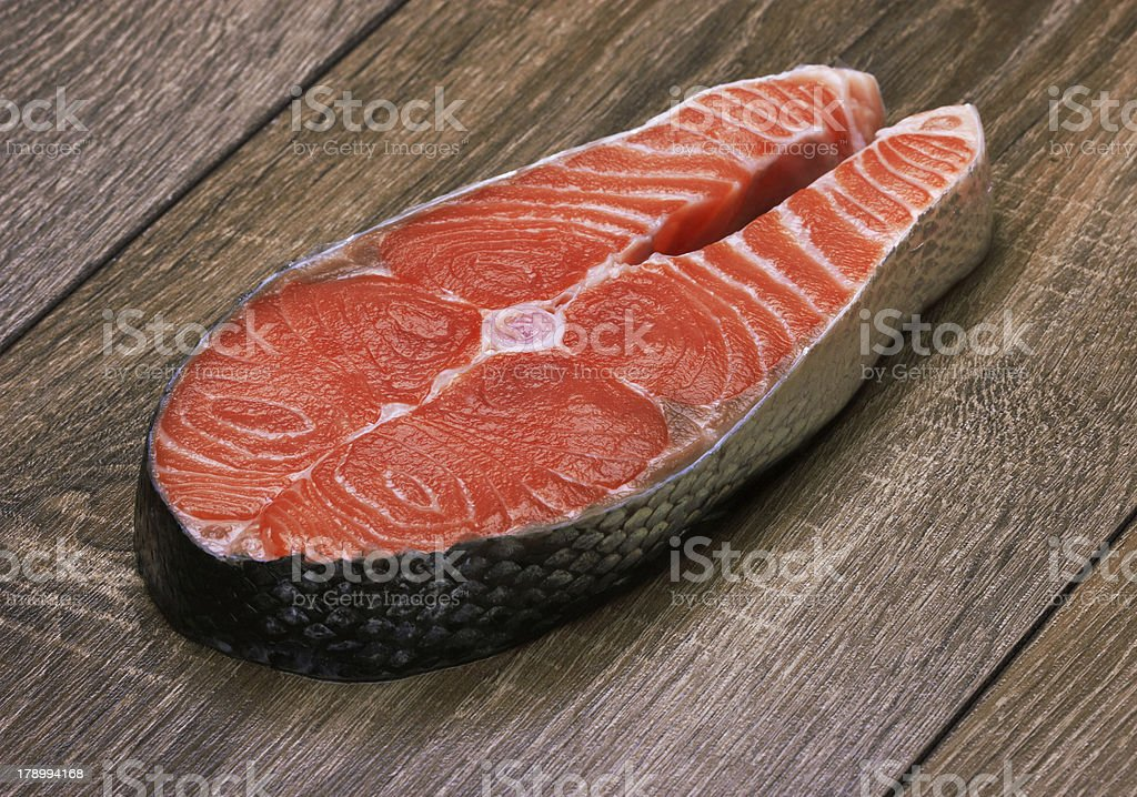 Piece of salmon on a wood royalty-free stock photo
