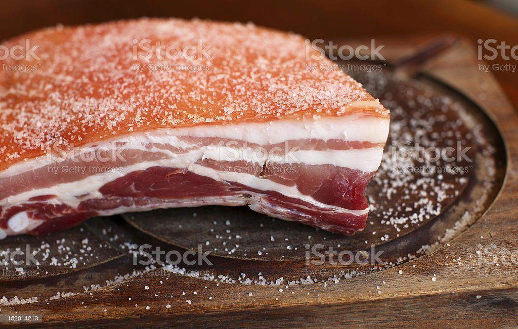 Piece of salted raw pork belly stock photo