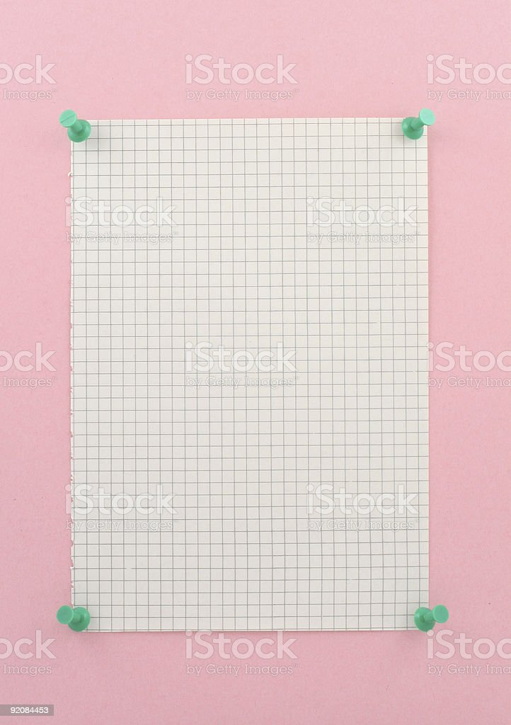 piece of squared paper pinned to pink wall royalty-free stock photo