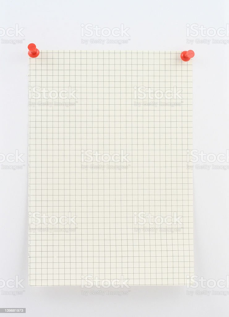 piece of squared paper pinned to white wall with pins royalty-free stock photo