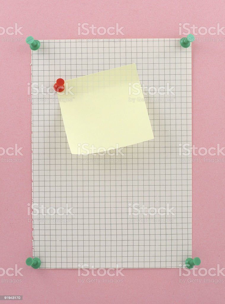 piece of squared paper with post-it stock photo