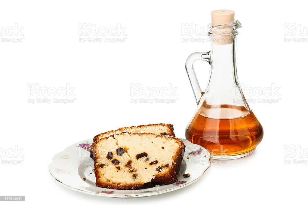 Piece of sweet cake with a decanter royalty-free stock photo