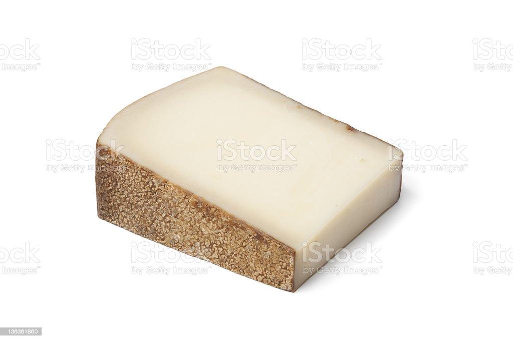 Piece of Swiss Gruyere cheese royalty-free stock photo