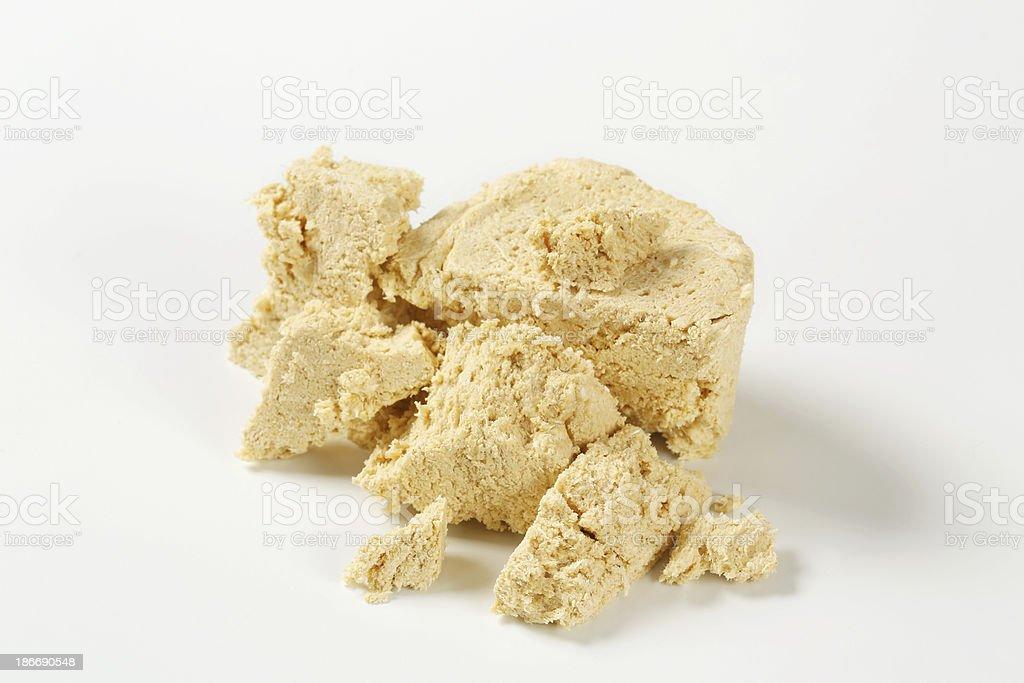 Piece of tasty halva isolated on white stock photo