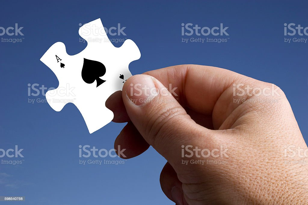 Piece of the Jigsaw with a Ace of Spades stock photo