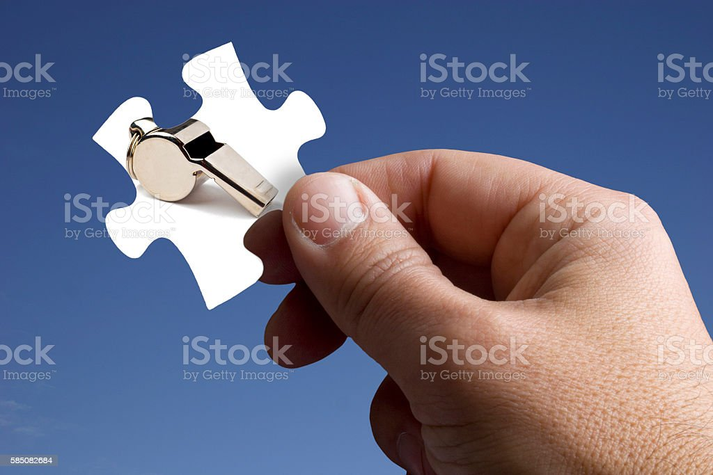 Piece of the Jigsaw with a Referee Whistle stock photo