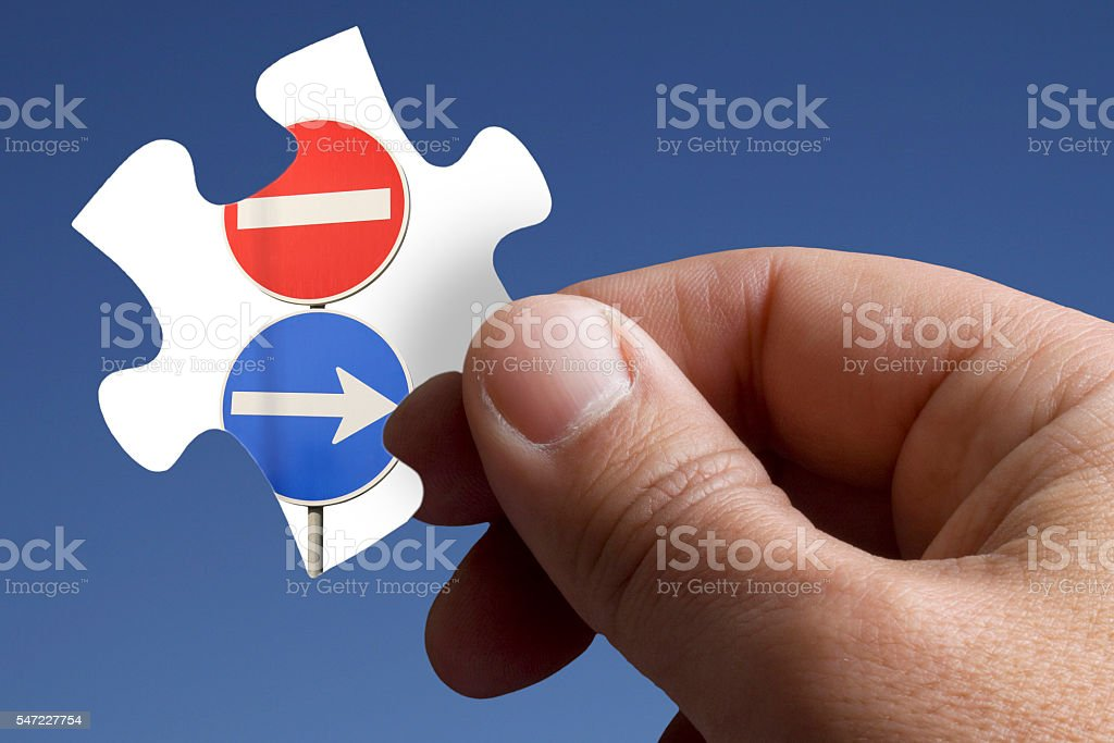 Piece of the Jigsaw with a Road Signs stock photo
