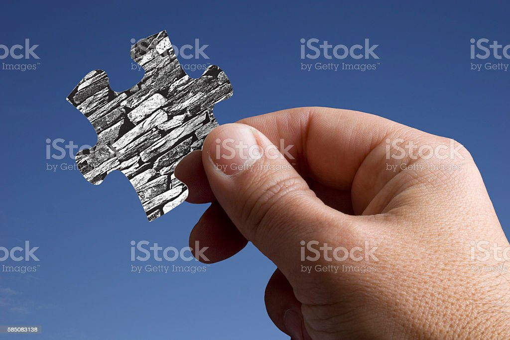 Piece of the Jigsaw with a Rustic Wall stock photo