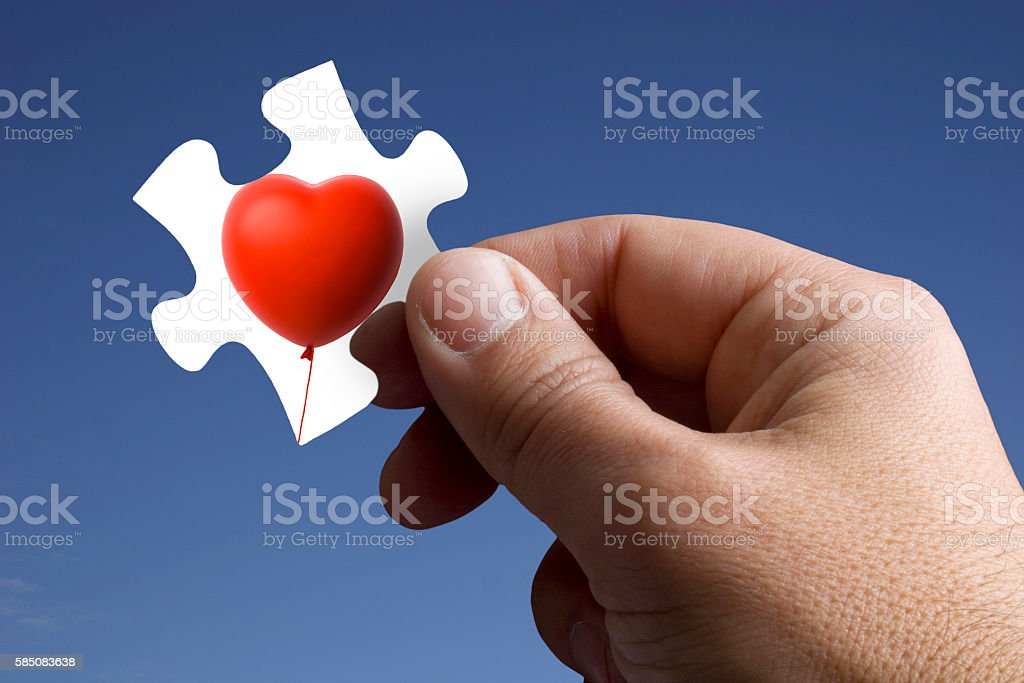 Piece of the Jigsaw with Heart Shape Balloon stock photo