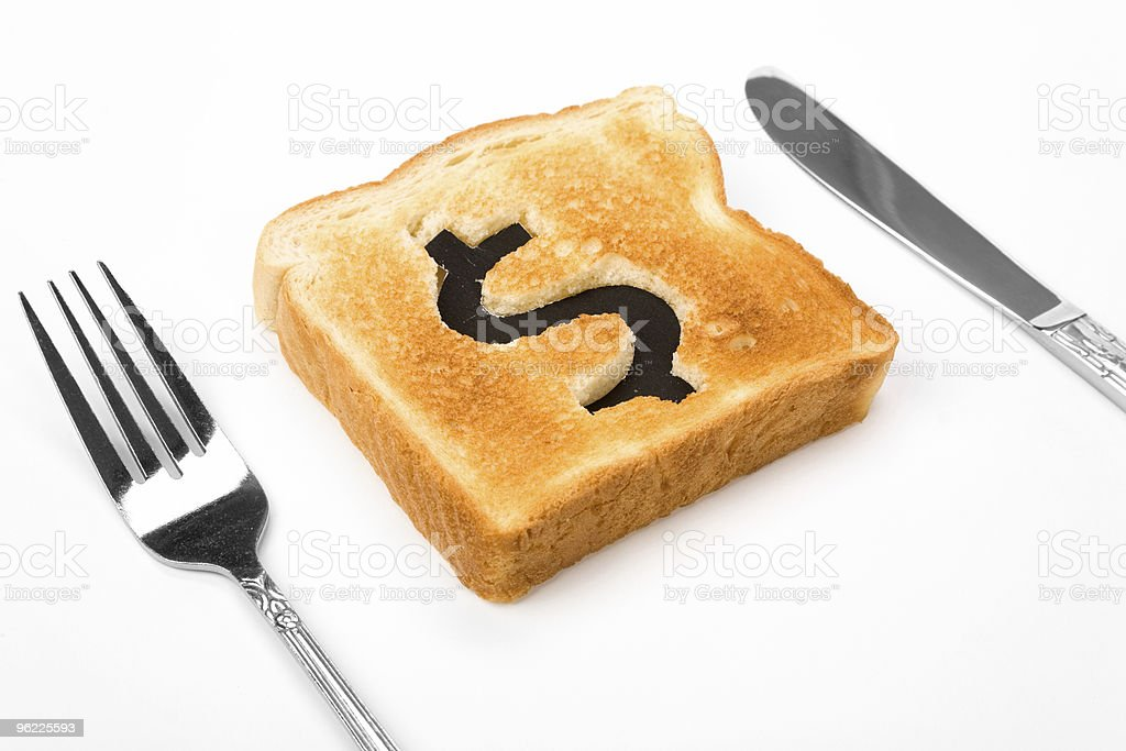Piece of toast with the dollar sign burned into it stock photo