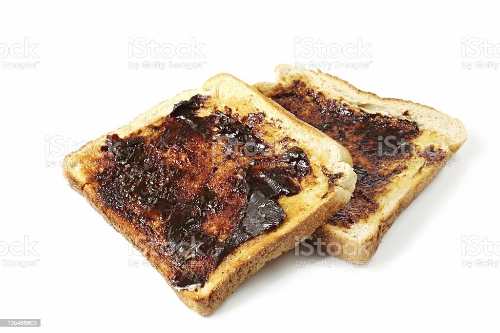 A piece of toasts slathered in Vegemite stock photo