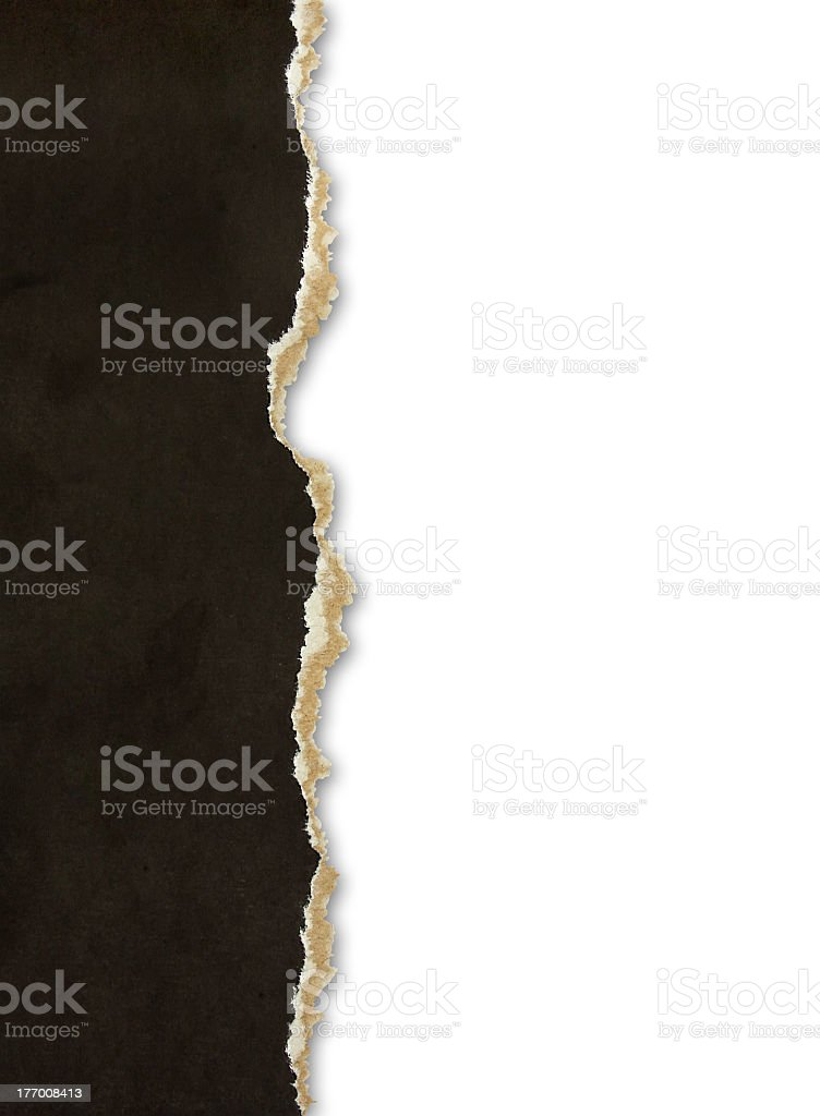 A piece of torn black paper on a white background stock photo