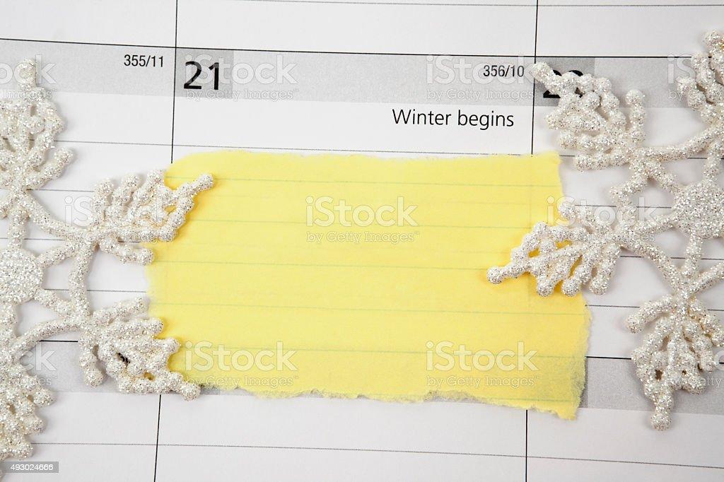 Piece of torn paper on Winter Calendar stock photo