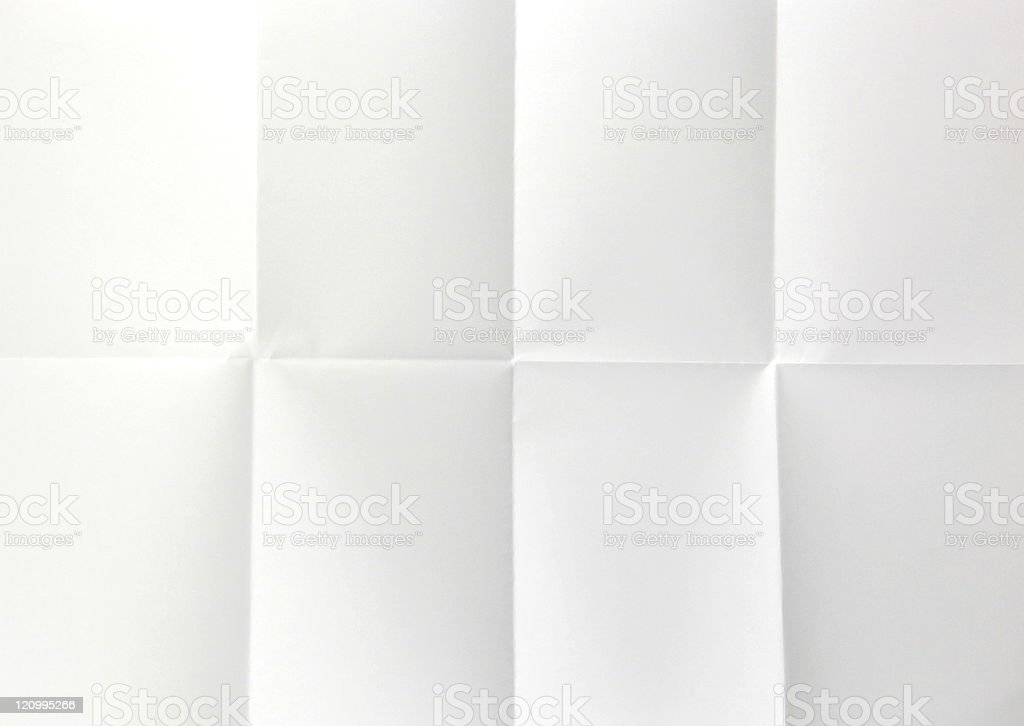 Piece of white paper with creases indicating folding stock photo