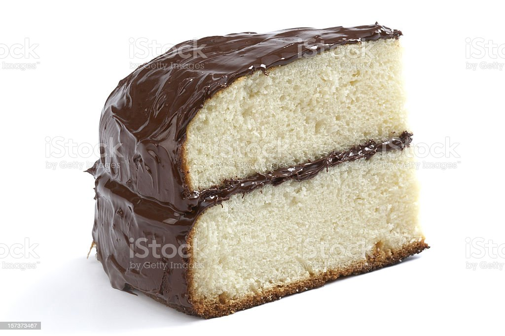 Piece of yellow cake with chocolate frosting stock photo