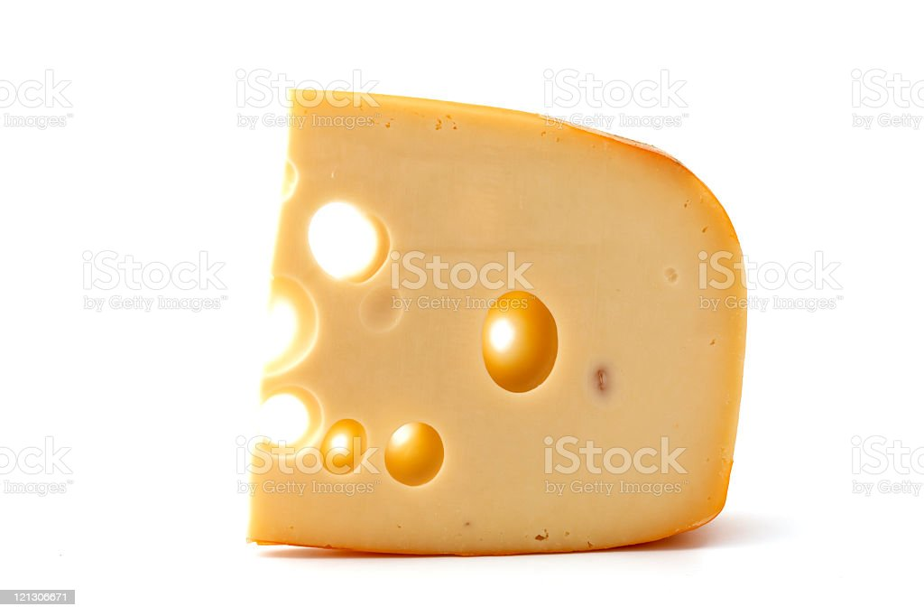 A piece of yellow cheese by itself stock photo