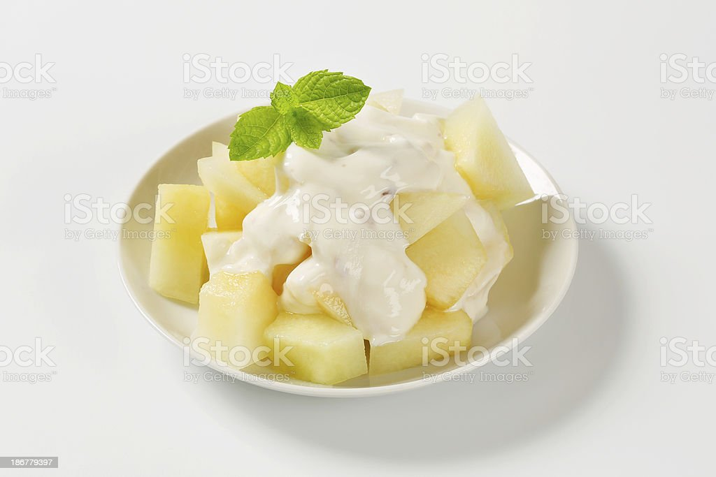 Piece of yellow melon in a wooden tray stock photo