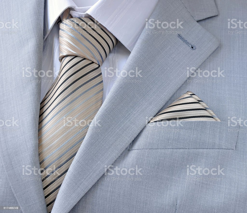 piece suit with white shirt, tie, scarf stock photo