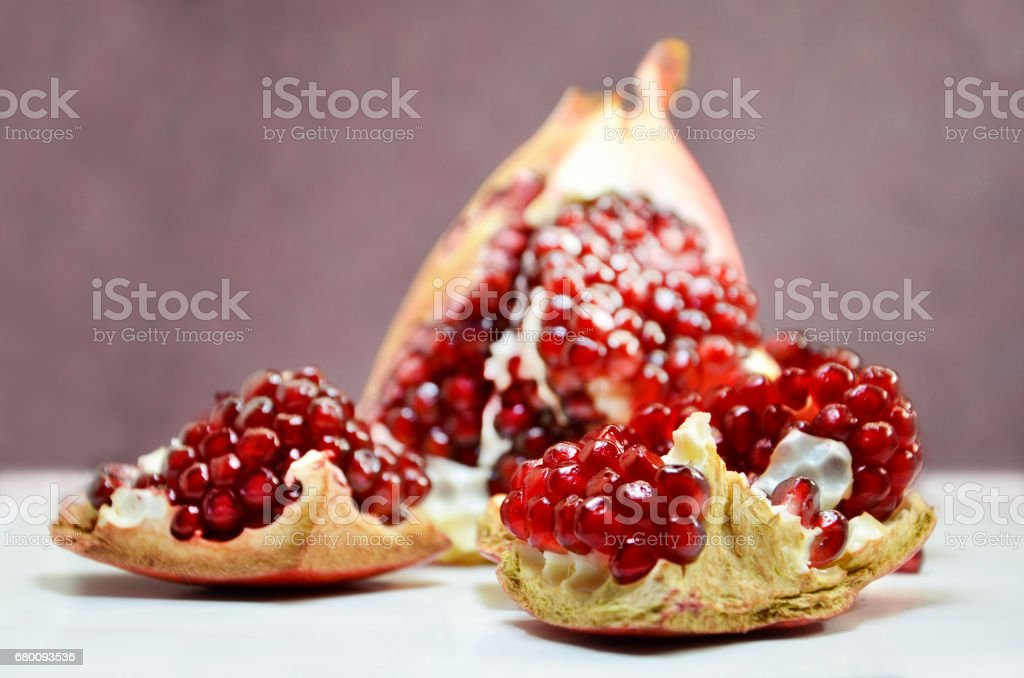 Pieces a pomegranate on a dark background stock photo