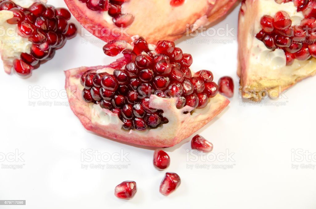 Pieces a pomegranate on a white background stock photo