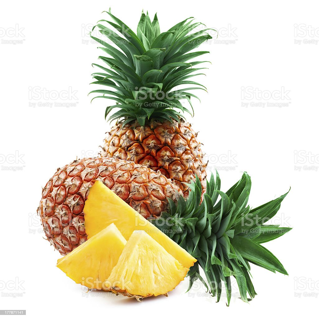 Pieces and entire pineapples on white background royalty-free stock photo