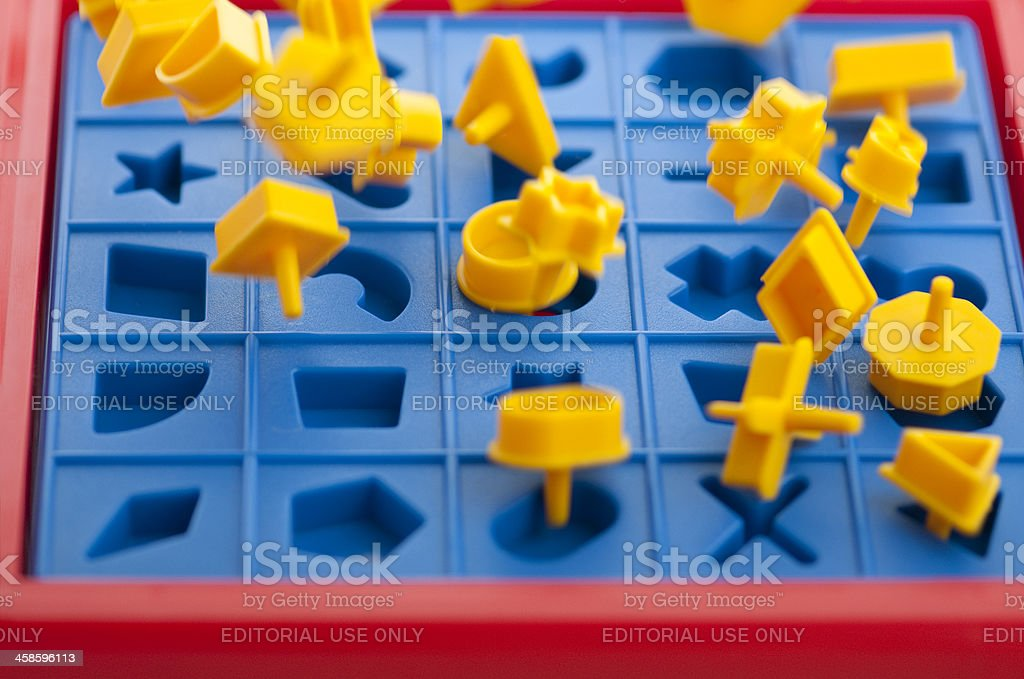 Pieces fly as board pops on game of Perfection royalty-free stock photo