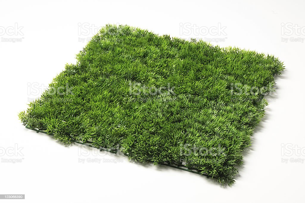 pieces of artificial plastic grass on white background stock photo