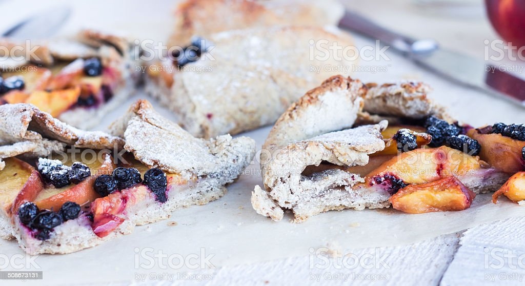 pieces of biscuits with peach and blueberry stock photo