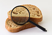 Pieces of bread and magnifier