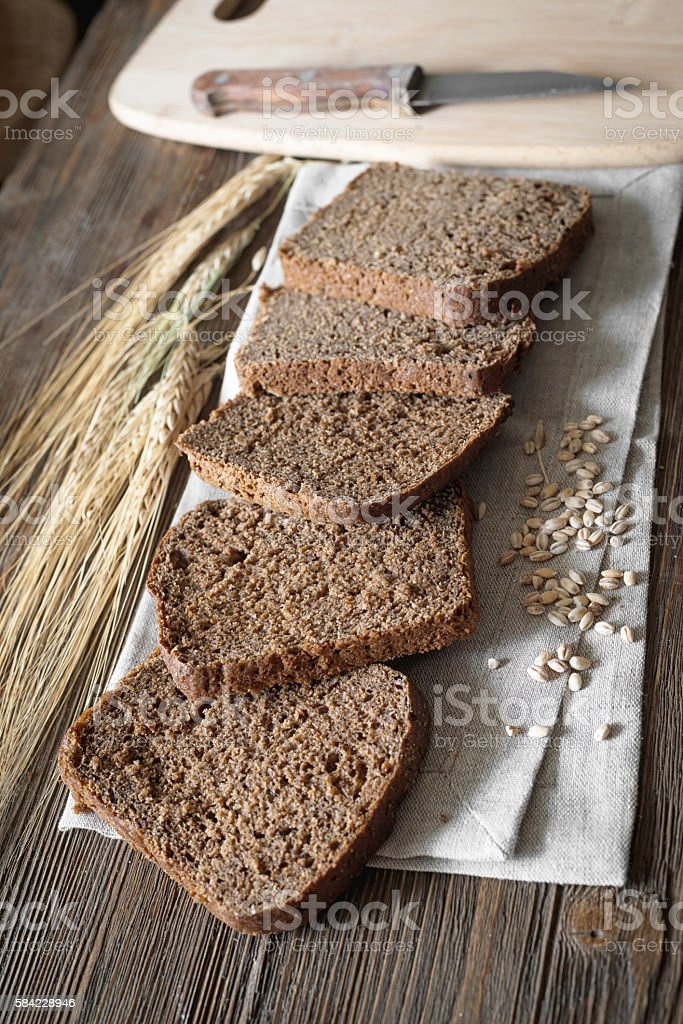 pieces of bread on a board with shallow depth of field stock photo