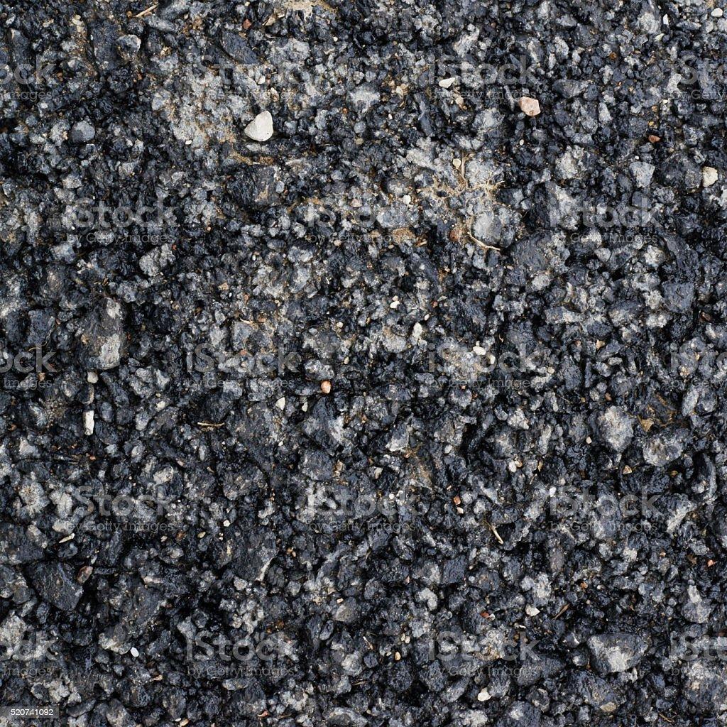 Pieces of broken bitumen asphalt stock photo