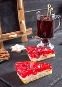 Pieces of cake with a strawberry filling and Mulled wine.