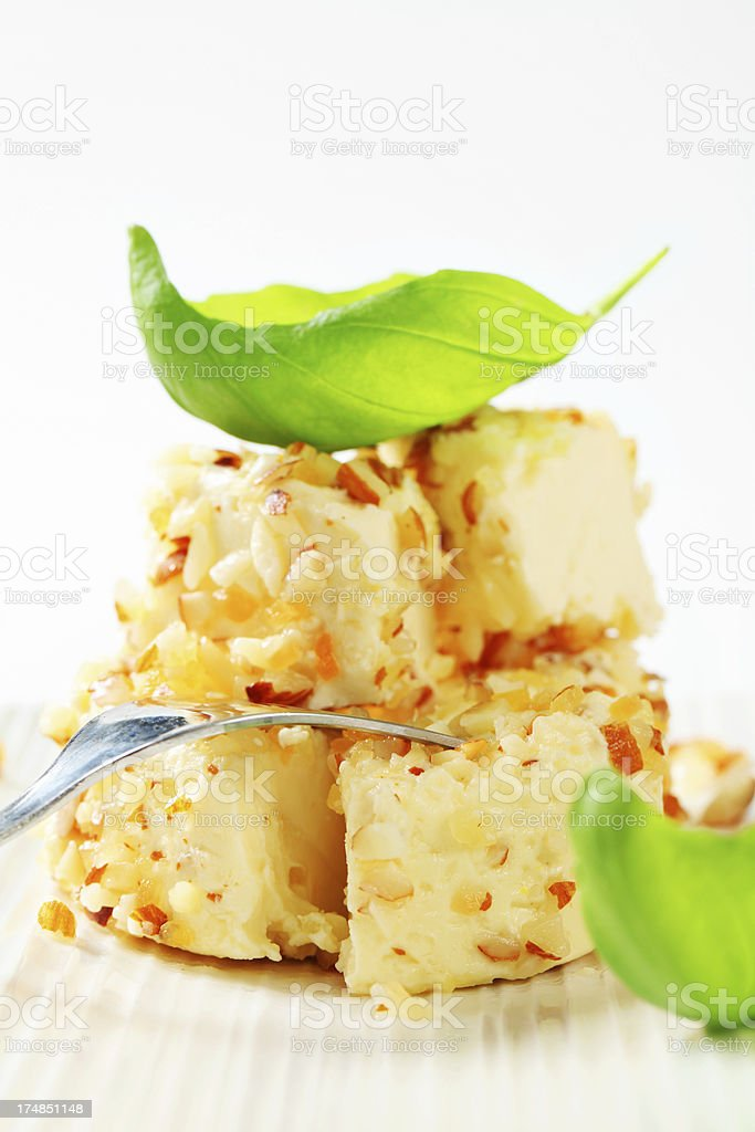 Pieces of cheese ring with almonds royalty-free stock photo
