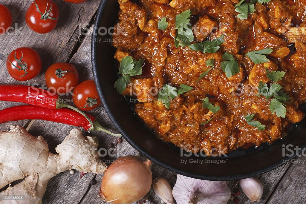 pieces of chicken fillet in curry sauce top view close-up stock photo
