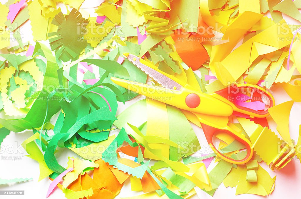 pieces of colored paper and scissors. Toned photo stock photo