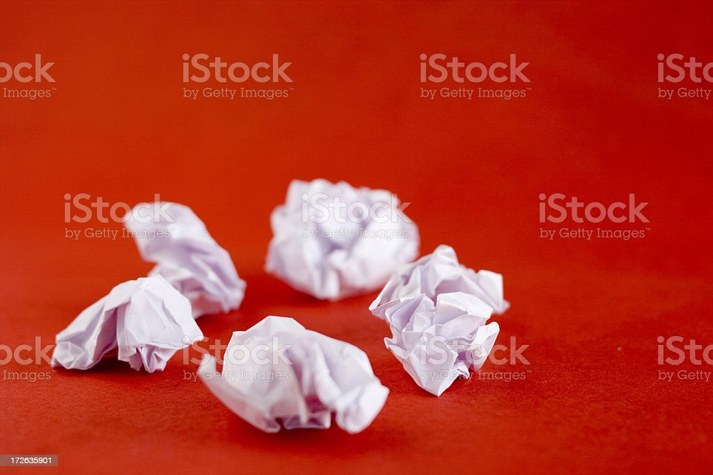 Pieces of Crushed crumpled papers while Brain Storming for ideas royalty-free stock photo