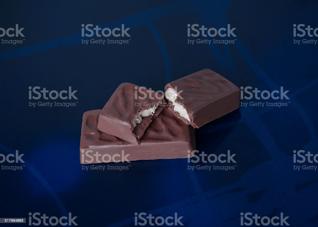 Pieces of dark chocolate stock photo