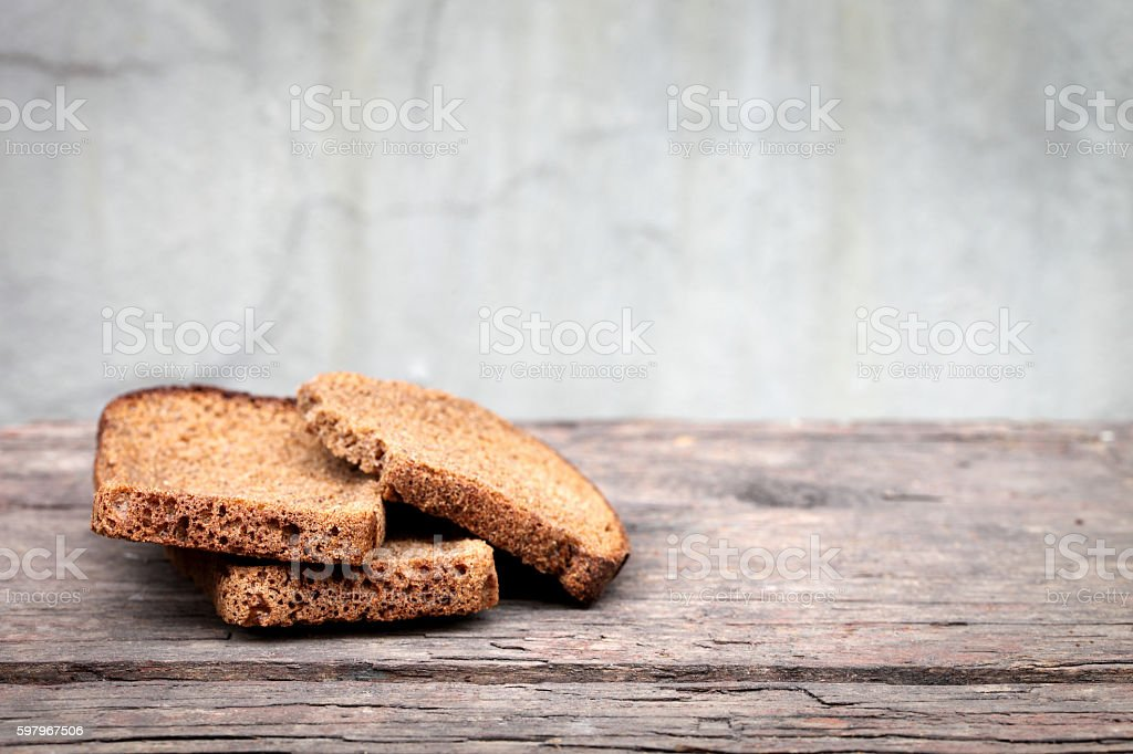 Pieces of dry rye bread stock photo
