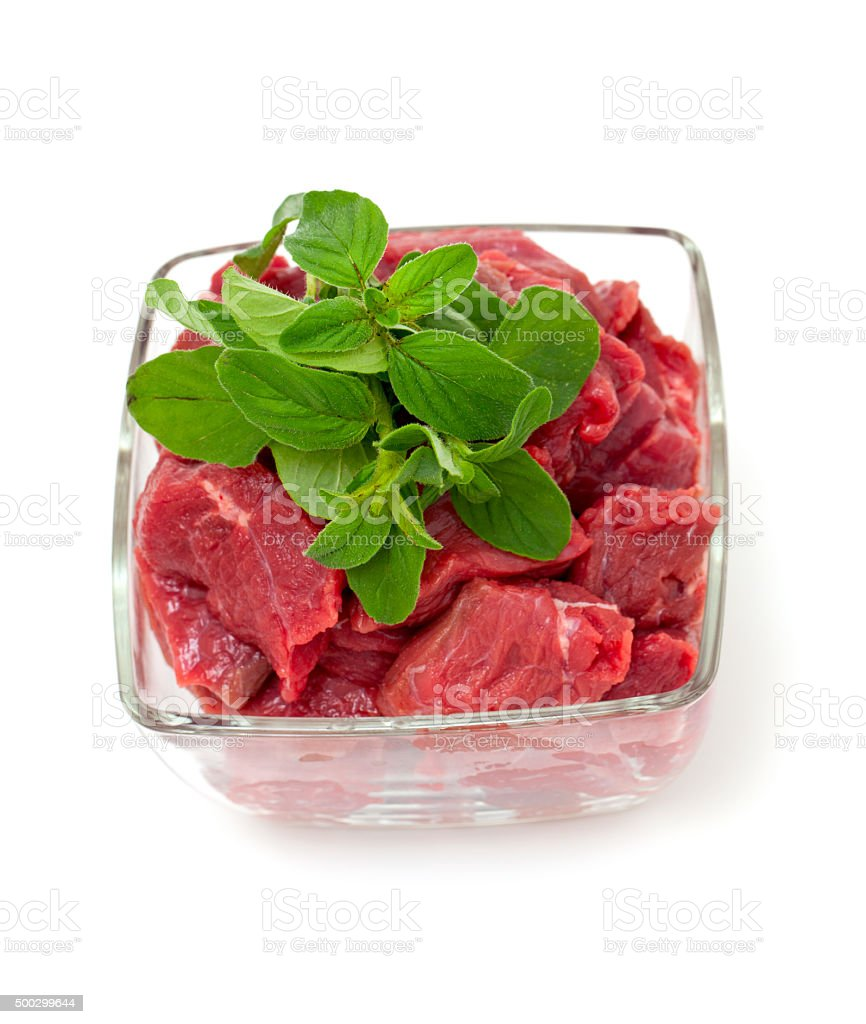 pieces of fresh beef in a glass bowl stock photo