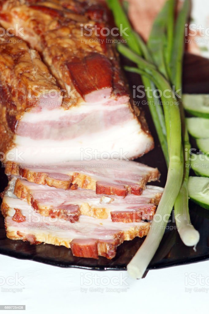 pieces of fresh cooked meat with spring onions stock photo