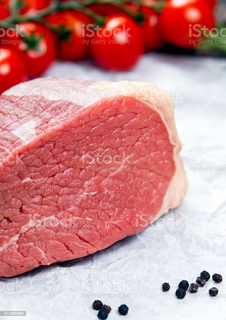 pieces of fresh meat, beef slab, decorated with vegetables stock photo