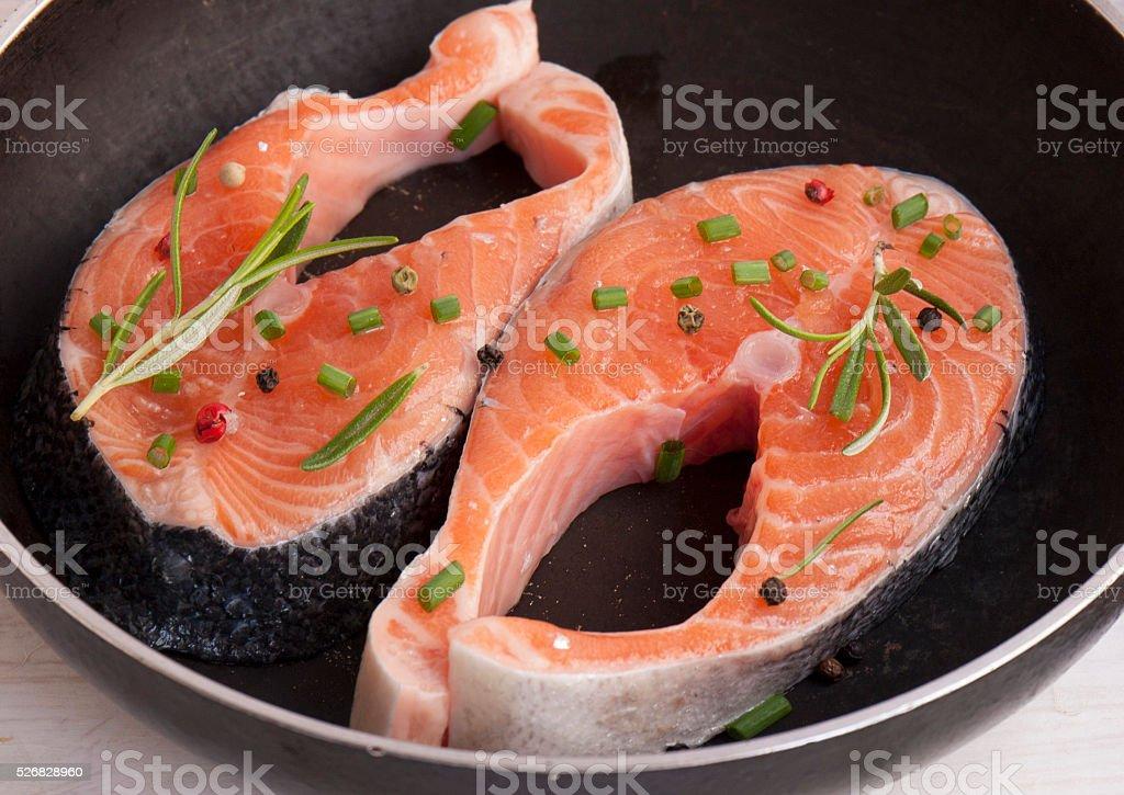 Pieces of fresh salmon on the pan.Fresh salmon stock photo