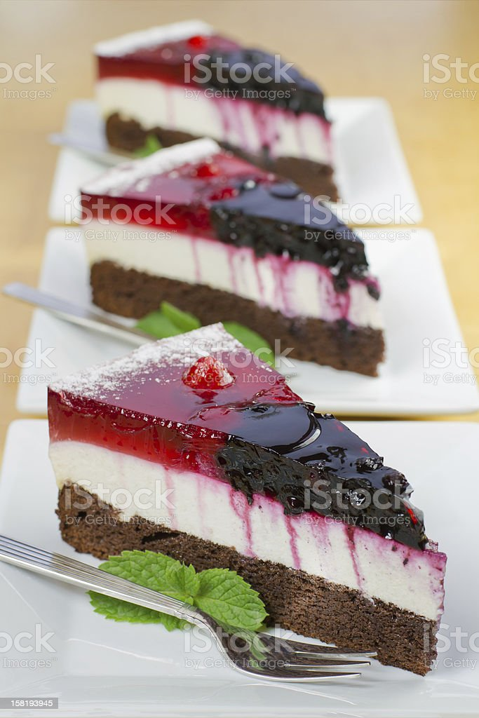 Pieces of homemade forest fruit cake royalty-free stock photo