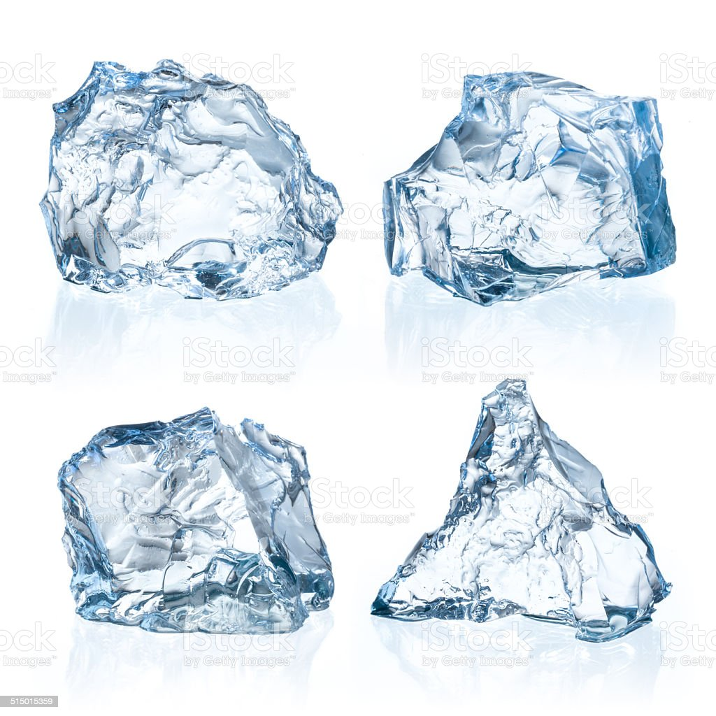Pieces of ice on a white background. stock photo