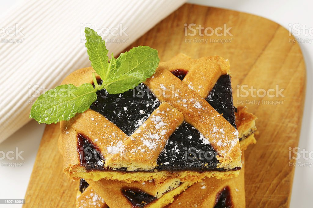 Pieces of Italian homemade tart on a cutting board royalty-free stock photo